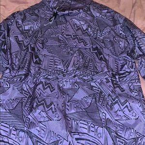 Purple windbreaker jacket with black designs